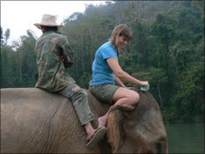 Mr Lid and Claudia Hammond riding on elephant Mae Bounnam
