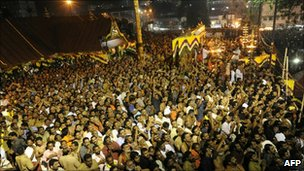 Hindu devotees pray at the Sabarimala temple, Kerala