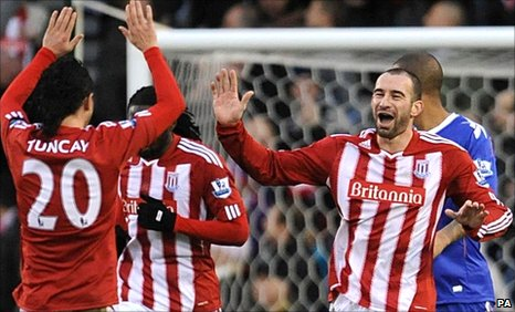 Tuncay (left) congratulates Danny Higginbotham (right) on his goal