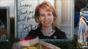 An autographed portrait of Congresswoman Gabrielle Giffords at a makeshift memorial outside the hospital in Tucson