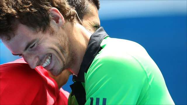 Novak Djokovic and Andy Murray hug at the net during Rally For Relief