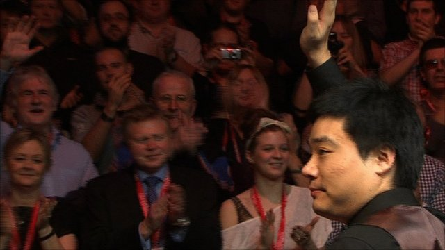 Ding Junhui celebrates his Masters win
