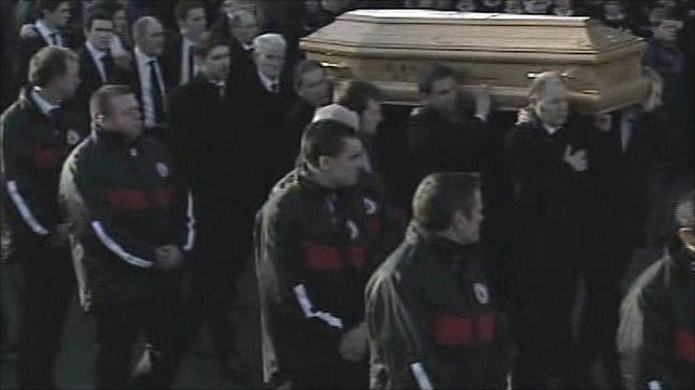 Funeral cortege arriving