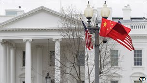 American and Chinese flags fly along Pennsylvania Avenue in front of the White House in Washington