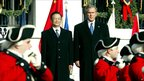 Former US President George W Bush and China's Premier Wen Jiabao review the ceremonial Old Guard during the state arrival ceremonies on the South Lawn of the White House (9 December 2003)