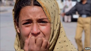 A Pakistani mourns the death of a relative at a blast site in Quetta on 27 October 2010