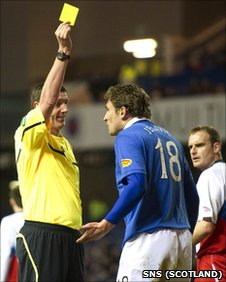 Rangers striker Nikica Jelavic is booked by referee Craig Thomson