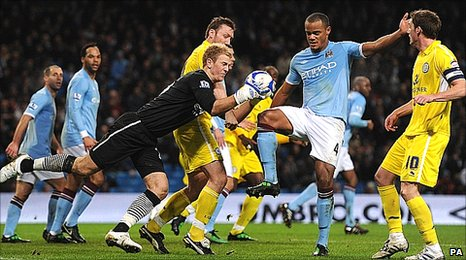 Man City keeper Joe Hart clutches the ball under pressure