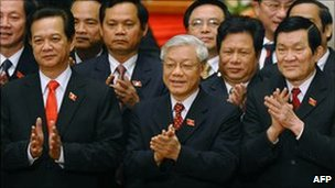 Sec General Nguyen Phu Trong (C), 66, poses with re-elected Politburo member and Prime Minister Nguyen Tan Dung (L) and re-elected Politburo member Truong Tan Sang (R) 19 Jan 2011