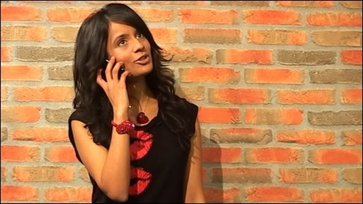 Sonali receiving a call from CBBC's Iain
