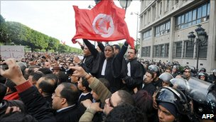 Tunisian demonstrators in front of the interior ministry in Tunis on 14 January 2011