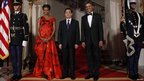 President Barack Obama and First Lady Michelle Obama flank Chinese President Hu Jintao