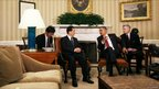 US President Barack Obama meeting with Chinese President Hu Jintao in the Oval Office at the White House