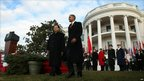 US President Barack Obama standing with Chinese President Hu Jintao at the White House