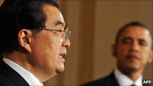 US President Barack Obama looks on as President Hu Jintao answers a question at the press conference in Washington on 19 Jan 2011