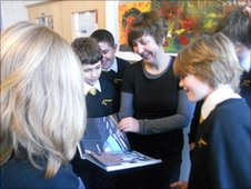 Hounsdown School pupils look at some Banksy artwork