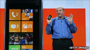 Steve Ballmer holds a Windows Phone 7 handset