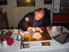 Ian Knowles painting an icon of Christ