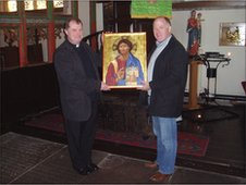 Ian Knowles presents the icon to the vicar of St Mary's Ian Gray