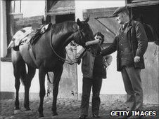 Red Rum pictured with Ginger McCain in 1974