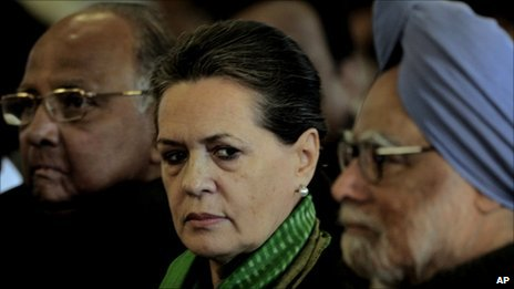 Indian Prime Minister Manmohan Singh, right, Congress party president Sonia Gandhi, centre and Indian Agriculture Minister Sharad Pawar, left, at the swearing-in ceremony of newly appointed ministers in Delhi, India, 19 January 2011
