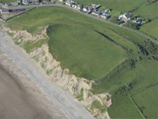 Dinas Dinlle Iron Age fort. © Crown copyright: Royal Commission on the Ancient and Historical Monuments of Wales
