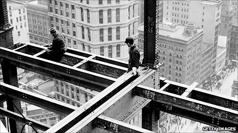 Workers reinforce the metal girders of a skyscraper in the 1920s