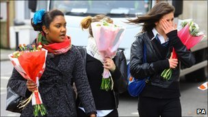 Mourners arrive at the scene in Tottenham, north London