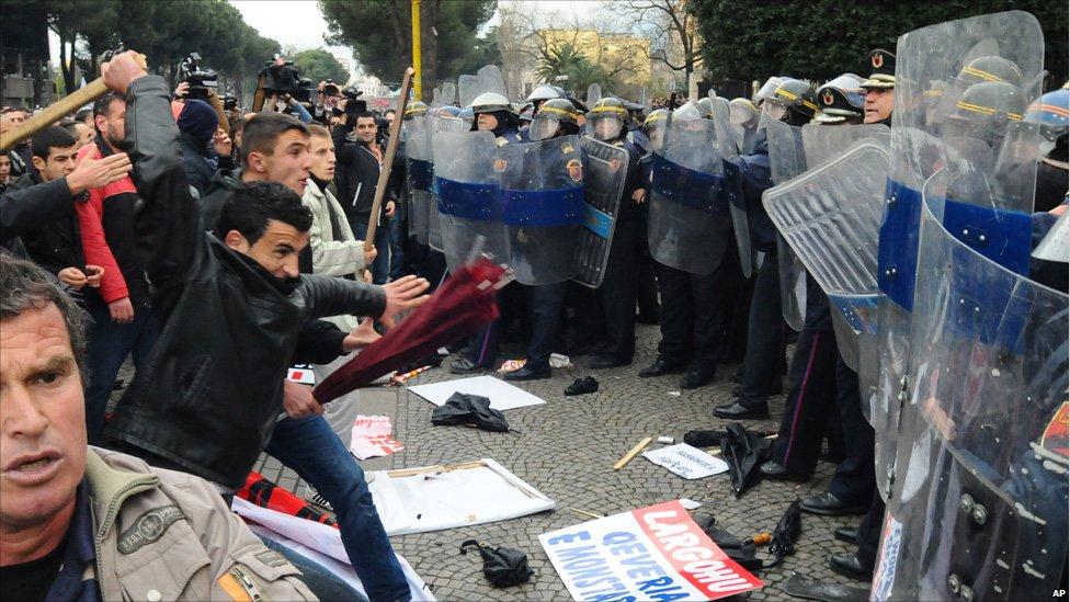 Protesters and police clash in Tirana