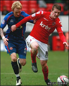 Steve Jones (left) in action for Walsall