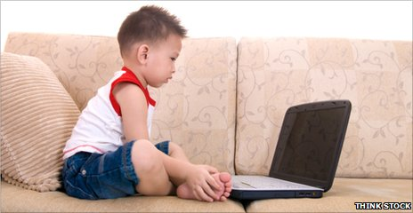 Toddler looking at a laptop