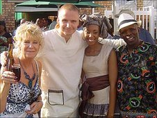 Christian's mother, Christian and his wife Kutlwano, and Bra Gugu