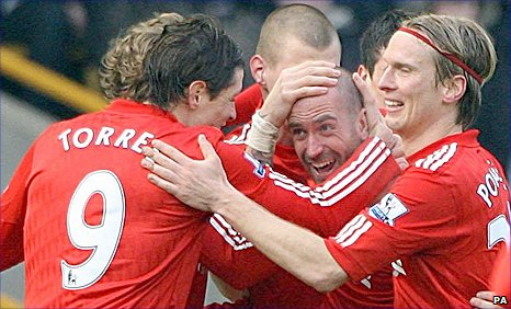 Raul Meireles is congratulated by team-mates after his spectacular goal
