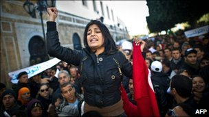 A woman gesticulates during a demonstration calling for the interim government to quit in central Tunis, 22 January 2011