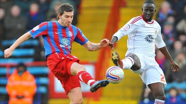 Crystal Palace's Darren Ambrose (left) and Bristol City's Albert Adomah battle for the ball
