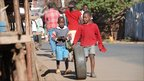Children with a tyre