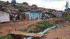 Kibera housing by a stream