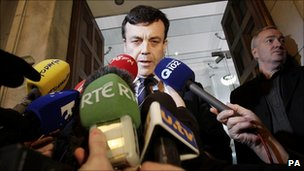 Irish Finance Minister Brian Lenihan speaking to the media outside the Finance department in Dublin, 24 January 2011