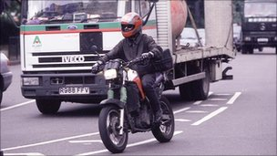 Motor bike in traffic, BBC