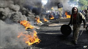"A Sunni protester burns tyres in the northern Akkar region of Lebanon on Tuesday as part of a ""day of rage"" against Hezbollah's growing political muscle"