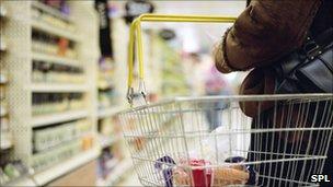 Shopper carrying a basket