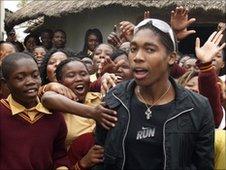 Caster Semenya surrounded by children
