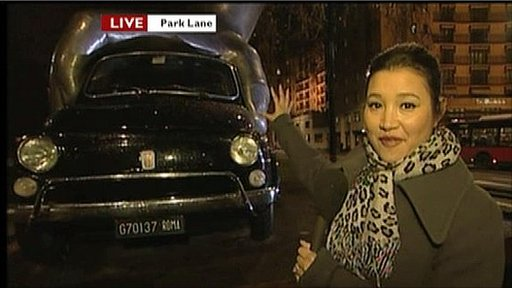 Reporter Alice Bhandhukravi with the Fiat car sculpture in Park Lane
