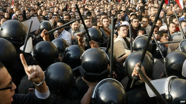 Egyptian demonstrators clash with police in Cairo, 25 January 2011