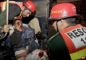 Injured police officer at site of suicide bombing in Lahore on 25 January 2011