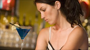Woman alone in a bar