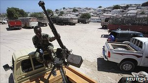 A Somali government soldier keeps guard near the Presidential Palace in the capital Mogadishu
