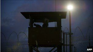 A member of the US military mans a guard post at Camp Delta, Guantanamo Bay, Dec 2010