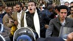 Protesters are confronted by riot police as they demonstrate in central Cairo