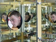 Museum employee Andreas Nitzschke tries out a cube fitted with mirrors intitled 'A view into infinity' at the Jena Optics Museum